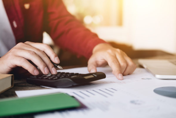 A person calculating reports